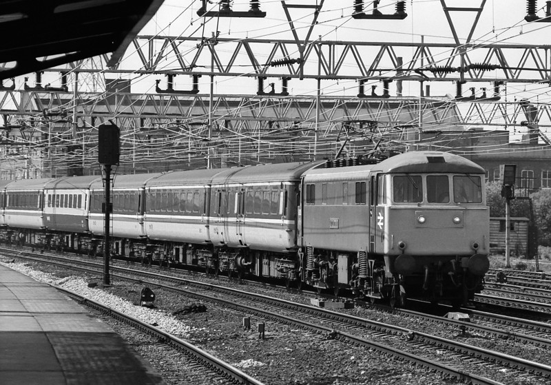 86205 heads a down Norwich express through Stratford on 16 May 1986
