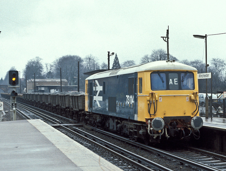 73114 runs through Winchester with an engineers' service on 22 March 1985