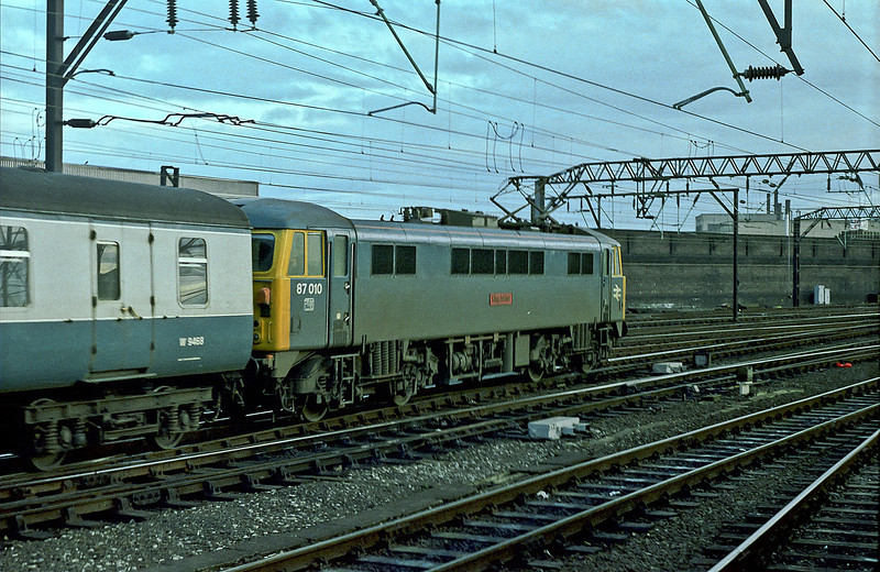 87010 is at Crewe on the evening of 25 November 1982
