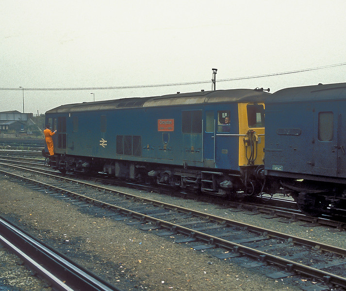 73121 still has its 'Croydon' nameplates but has lost the coat of arms as it shunts some vans at Eastleigh on 12 October 1986