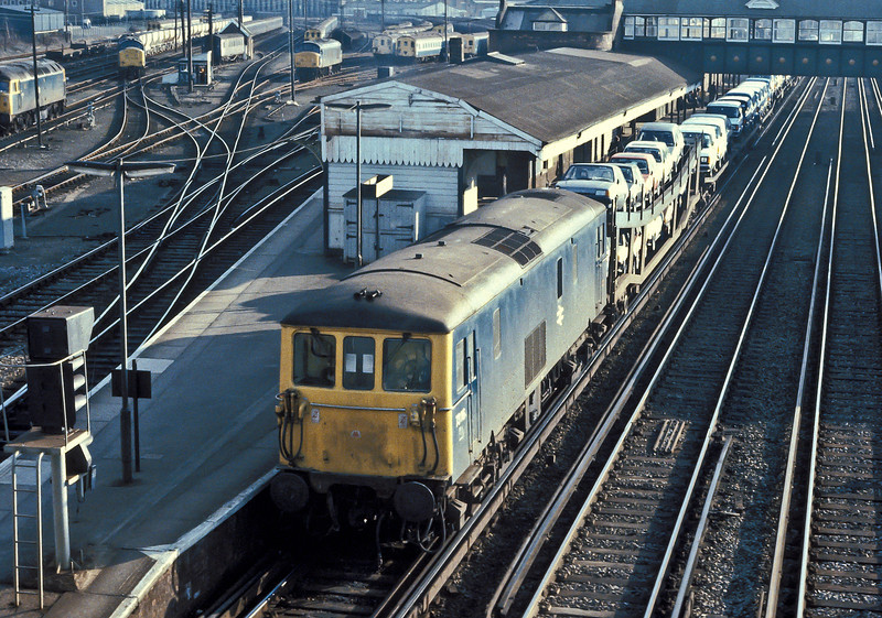 73116 has a trainload of motor vehicles heading into the yard at Eastleigh on 5 March 1985