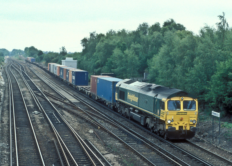 66540 'Ruby', the Freightliner 40th Anniversary loco, heads past Worting Junction on 3 August with 4E44 Southampton to Leeds