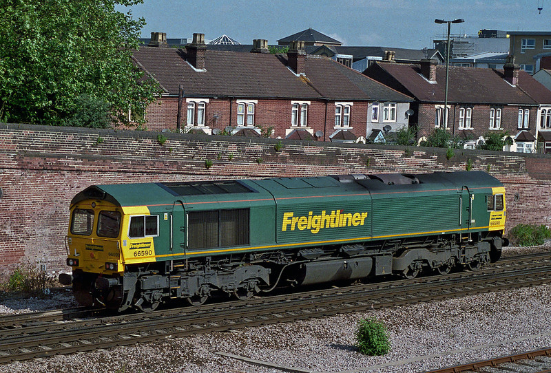66590 runs north through Eastleigh as a light engine movement on 16 June 2008