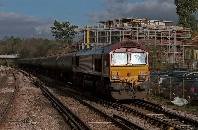 66213 heads into the low afternoon sun with the late-running Holybourne tanks seen at Haslemere on 27 February 2008