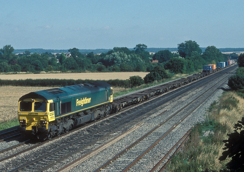 66535 has a lightly loaded Southampton to Coatbridge Freightliner service rolling past Cholsey on 3 August 2006