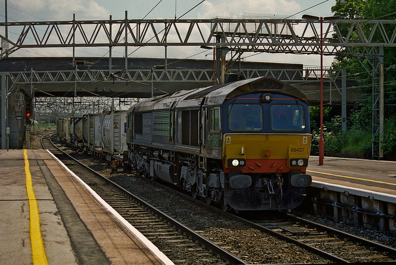 DRS 66427 runs north through Stafford with the daytime service from Daventry on 5 June 2009
