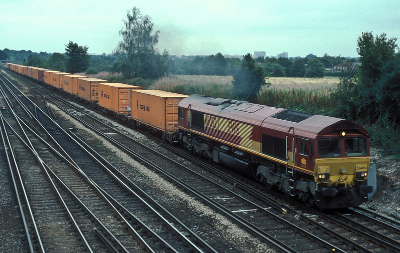66052 at Worting Junction with 4O53, the Wakefield to Southampton, on 3 August 2006