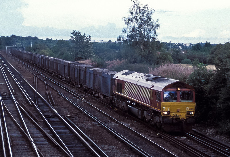 66081 passes Worting Junction with the Mountfield gypsum working, usually a GBRaill class 66 turn, on 20 August 2004