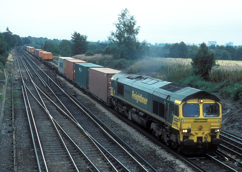66532 heads south with 4O27 Garston - Eastleigh at Worting Junction on 1 December 2009