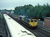 66538 passes a down Wessex Electric at Worting Junction while working 4M50, the Southampton to Hams Hall liner service, having run via the Test Valley and Laverstock on 3 August 2006