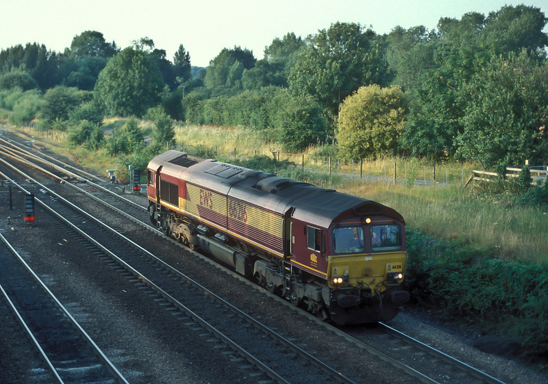 The evening shadows are lengthening as 66216 runs light engine toward knottingley on 6 July 2006