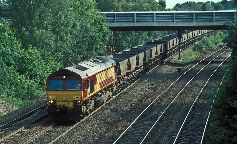66021 heads north through Monk Fryston on 6 July 2006 with a load of empty MGR wagons