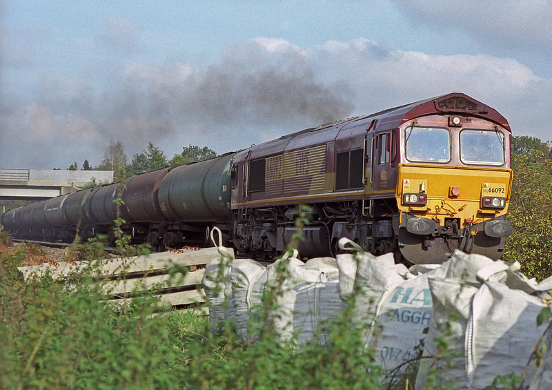 66092 smokes its way into Petersfield on 18 October 2006 with the Hollybourne tanks