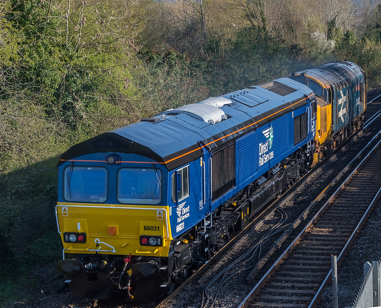 66031 being hauled by 37407 at St. Cross, Winchester 16 April 2021