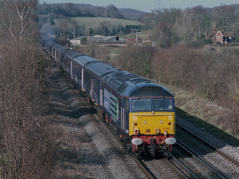 47802 follows on at the rear of the 'Stobart Pullman' as the train heads up the South Downs at Idsworth on 12 February 2008