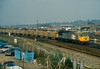 56058 crosses the main line at Eastleigh with a stone service from Whatley, probably to Fareham, on 13 October 1986