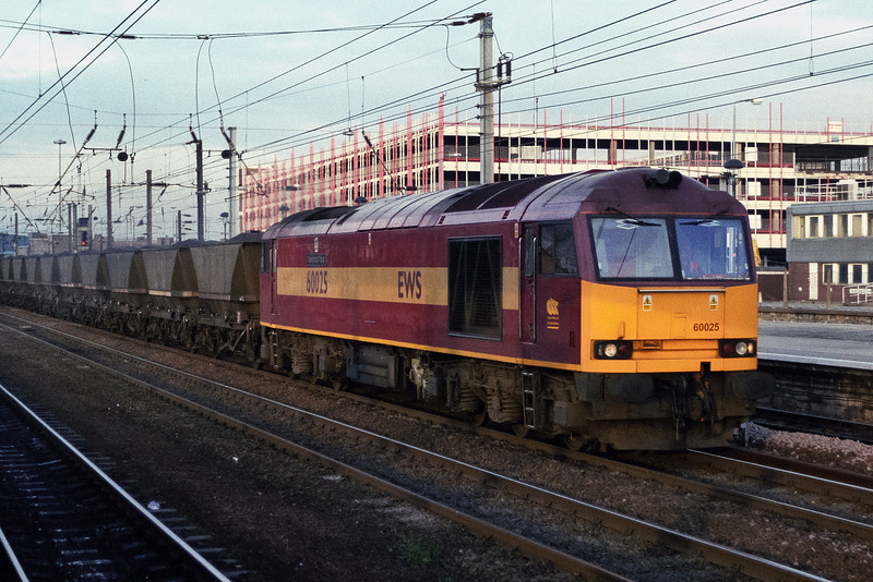 60025 heads a train of HAA coal wagons south through Doncaster on 28 November 2003