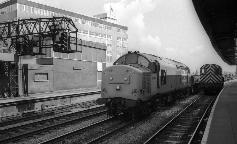 Passing an 08 in the platform 37904 passes Newport with a steel service in May 1988