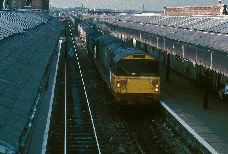 Part of the constant stream of MGR workings through Worksop, 58029 passes the station on 11 November 1985