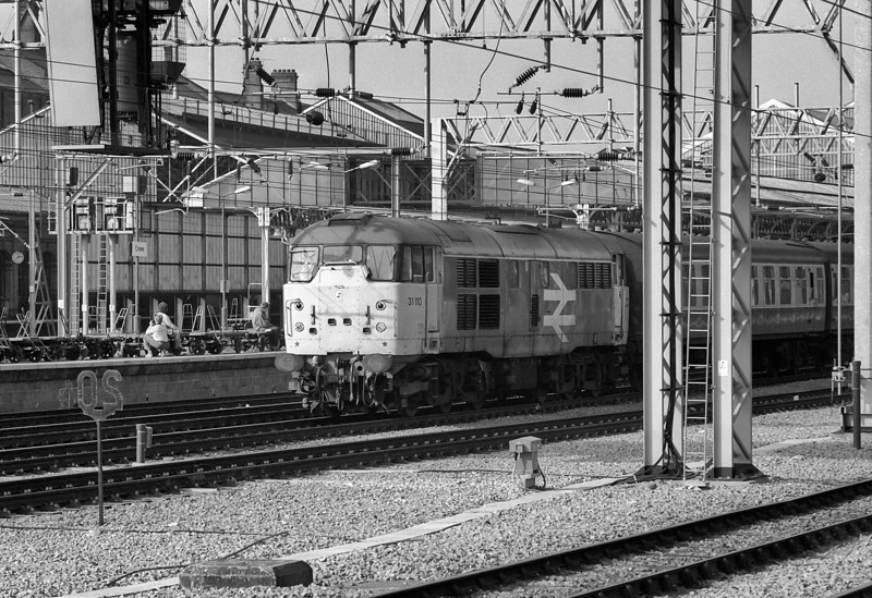 'Skinhead' 31110 appears to be ignored by the number takers at Crewe as it runs through the station with an empty stock working on 30 September 1985