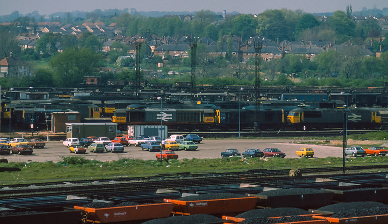 58042 sits in the yard at Toton TMD surrounded by many sister locomotives on 28 April 1987