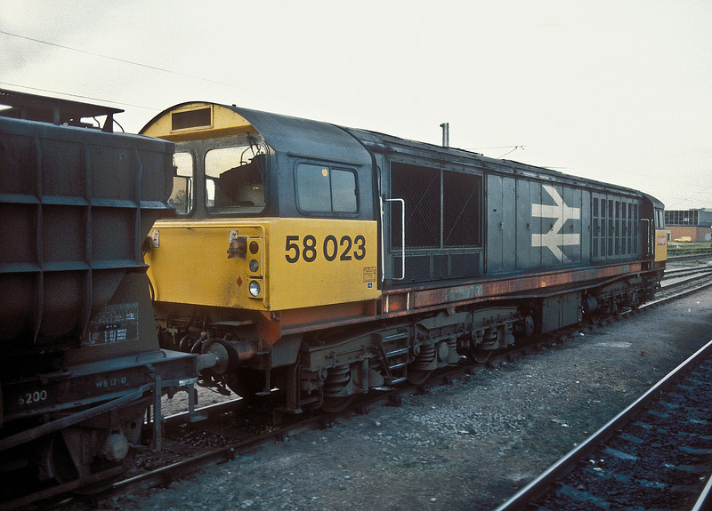 58023 pauses at Peterborough with the fly ash empties from Fletton on 12 November 1986