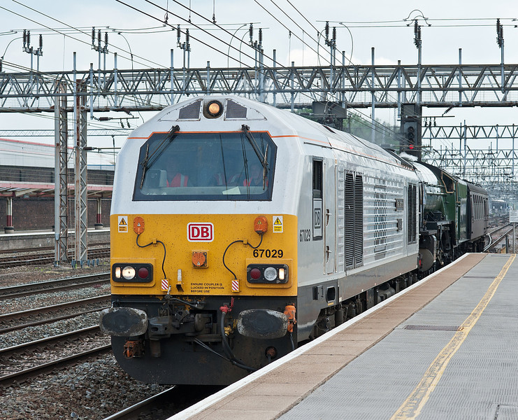 With 60163 'Tornado' and support coach in tow 67029 heads north through Crewe on 1 June 2012