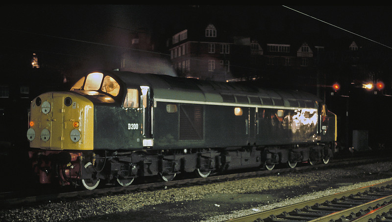 Waiting in the yard to work a passenger service to Liverpool, 'celebrity' 40122 - repainted into green livery and numbered D200 - is at Preston on 19 March 1985