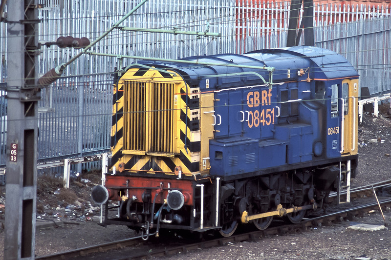 GB Railfreight 08451 sits in the yard at Willesden depot on 23 August 2004
