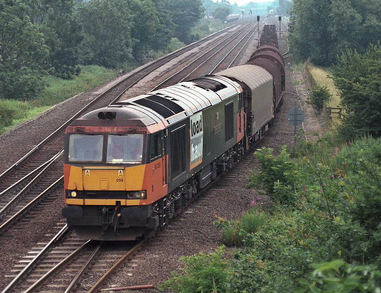 Finding a Class 60 is hard enough nowadays let alone one of the old liveries but 60059 is pictured leaving the north end of Milford Junction down sidings on 6 July 2006