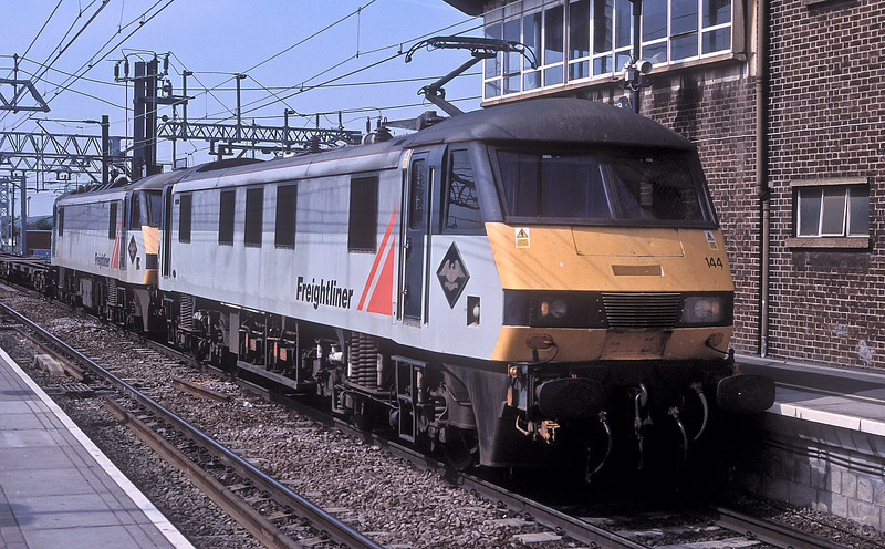 90144 and 90149 double-head a service for Felixstowe through Stratford on 16 August 2002