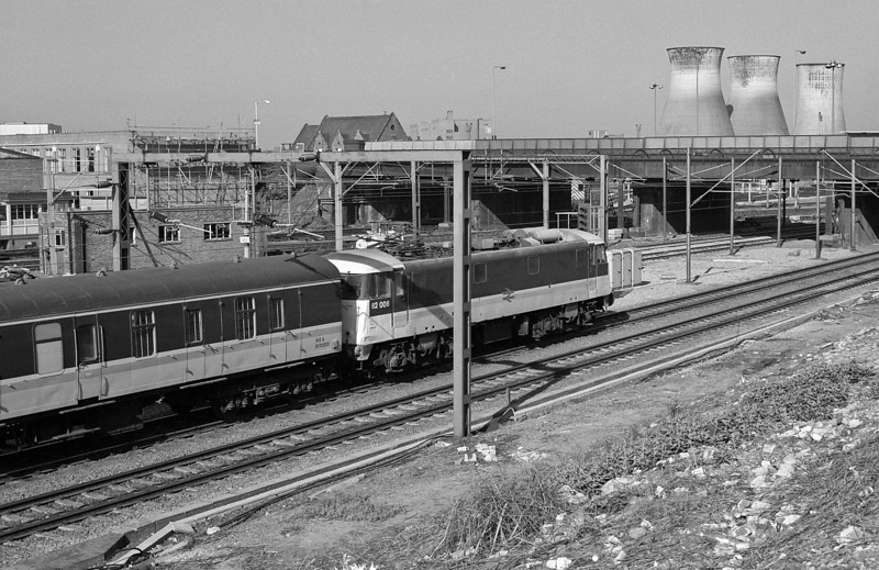 One of the locos painted into InterCity livery for working empty stock at Euston, 82008 passes Willesden with ecs on 16 May 1986
