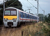 321421 is still in NSE livery as it pulls into Tile Hill late in 1998