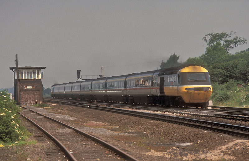 An Eastern region HST set powers past Thirsk signal box on 6 July 1987