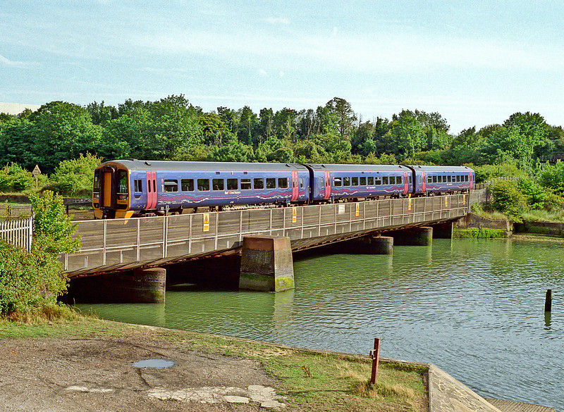 FGW-liveried 158953 crosses Portcreek as it approaches Portsmouth from Cardiff on 30 July 2009