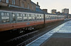 SC52023 is closest to the camera in a Strathclyde livery Class 107 unit at Ayr on 10 November 1985