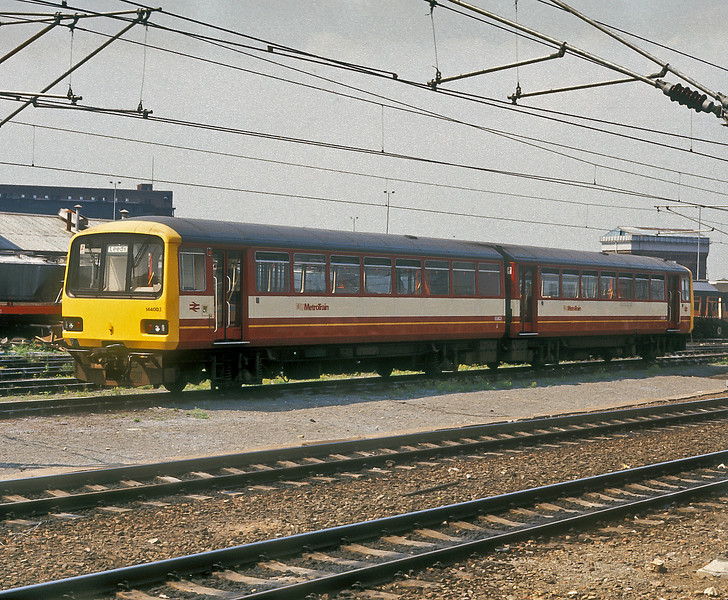 144003 was in the original 'Metro' livery at Doncaster on 3 July 1987 as the electrification around the station gathered pace