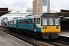 142 093 at Salford Central on 31st March 2008, working to Wigan Wallgate