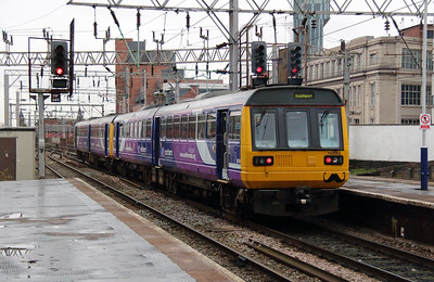 142 060 at Manchester Oxford Road on 27th November 2013.