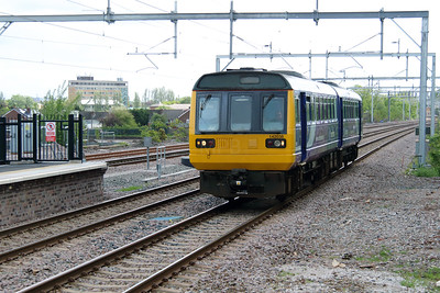 142 038 at Roby on 19th May 2015 working 2F39