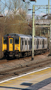 317 888 at Harlow Town on 3rd March 2015 working 2S30