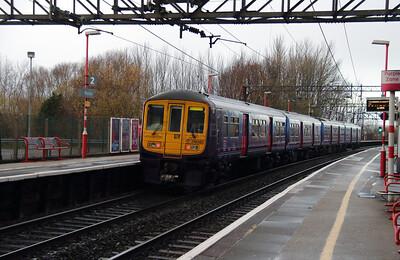 319 380 at Runcorn on 8th December 2014 (5)