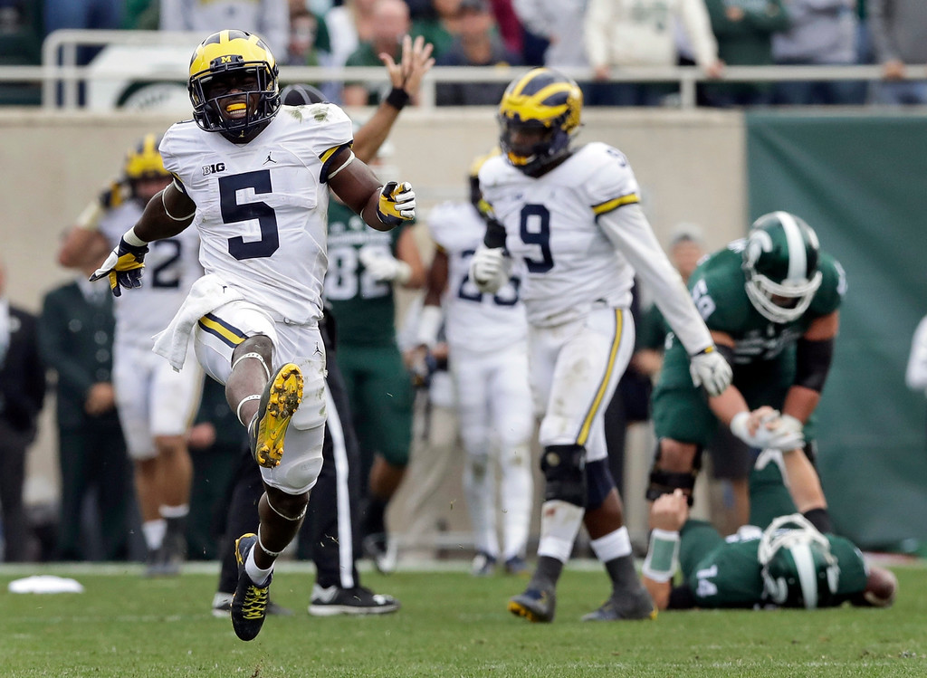 . Michigan linebacker Jabrill Peppers (5) celebrates after sacking Michigan State quarterback Brian Lewerke (14) during the second half of a college football game, Saturday, Oct. 29, 2016, in East Lansing, Mich. Michigan defeated Michigan State 32-23. (AP Photo/Carlos Osorio)