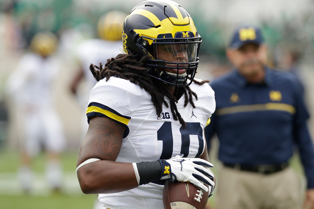 . Michigan linebacker Devin Bush makes a catch before the college football game against Michigan State, Saturday, Oct. 29, 2016, in East Lansing, Mich. (AP Photo/Carlos Osorio)