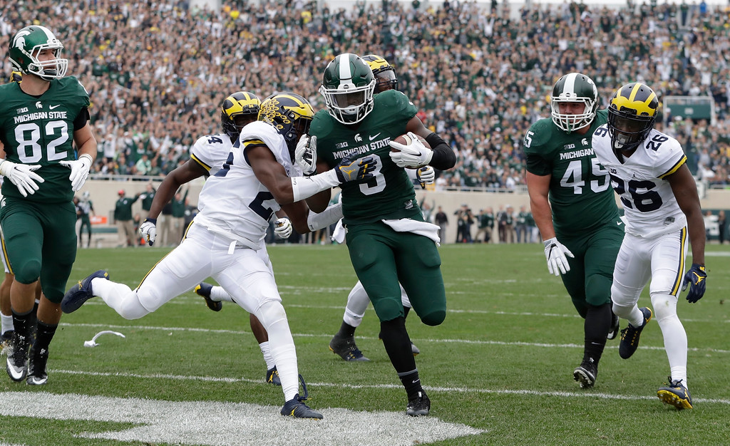 . Michigan State running back LJ Scott (3) runs into the end zone for a touchdown during the first half of an NCAA college football game against Michigan, Saturday, Oct. 29, 2016, in East Lansing, Mich. (AP Photo/Carlos Osorio)