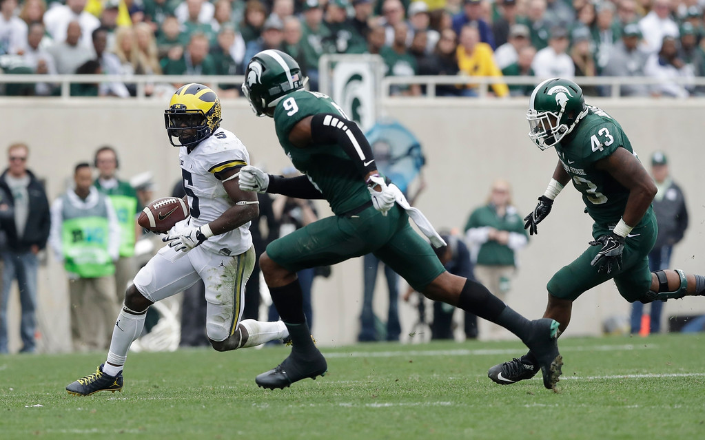 . Michigan linebacker Jabrill Peppers (5) returns a kickoff during the first half of a college football game against Michigan State, Saturday, Oct. 29, 2016, in East Lansing, Mich. (AP Photo/Carlos Osorio)