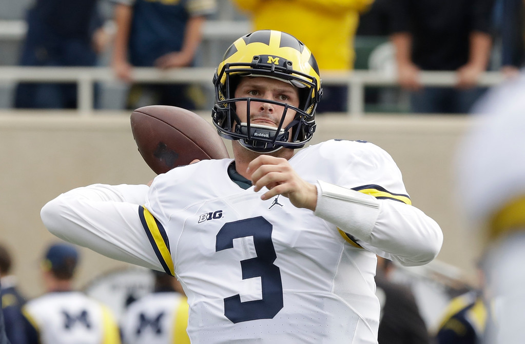 . Michigan quarterback Wilton Speight warms up before the college football game against Michigan State, Saturday, Oct. 29, 2016, in East Lansing, Mich. (AP Photo/Carlos Osorio)