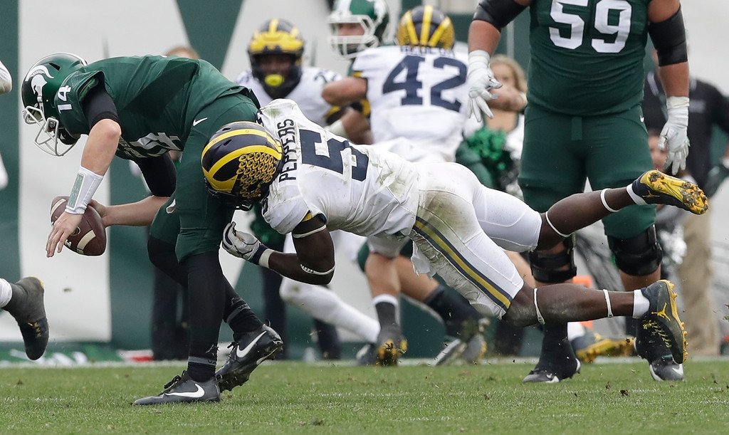 . Michigan linebacker Jabrill Peppers (5) sacks Michigan State quarterback Brian Lewerke (14) during the second half of a college football game, Saturday, Oct. 29, 2016, in East Lansing, Mich. Michigan defeated Michigan State 32-23. (AP Photo/Carlos Osorio)