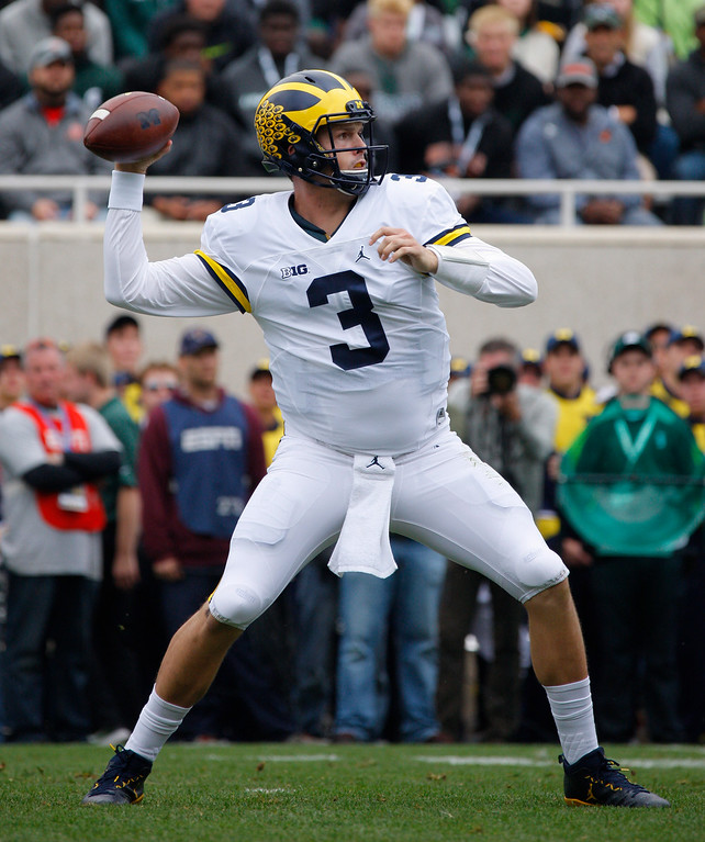 . Michigan quarterback Wilton Speight throws a pass against Michigan State during the second quarter of an NCAA college football game, Saturday, Oct. 29, 2016, in East Lansing, Mich. (AP Photo/Al Goldis)