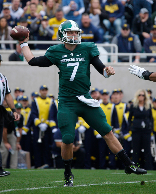 . Michigan State quarterback Tyler O\'Connor throws a pass against Michigan during the first quarter of an NCAA college football game, Saturday, Oct. 29, 2016, in East Lansing, Mich. (AP Photo/Al Goldis)